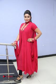 Actress Poorna Latest Stills in Red Dress at Rakshasi First Look Launch  0307.JPG
