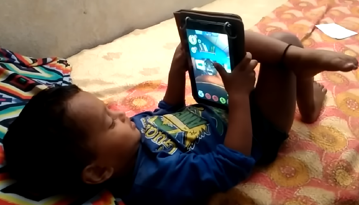 Kid playing games in a phone