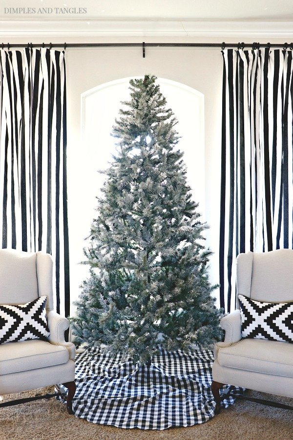 artificial christmas tree, how to flock a christmas tree, snowy christmas tree, black and white striped curtains, gingham tree skirt