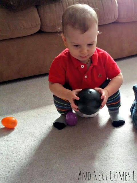 K holding a bowling ball from And Next Comes L