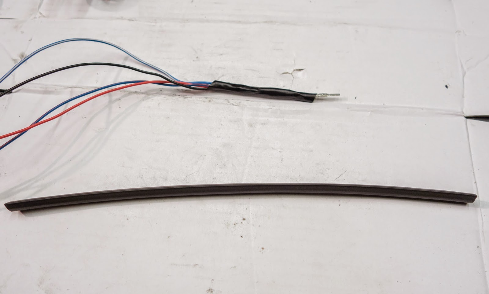 Tape the wires together ready for inserting into heat shrink tubing