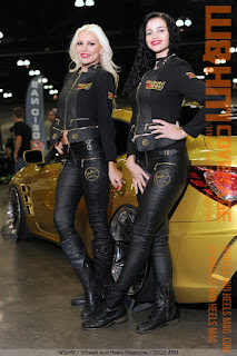 Spearmint Rhino Girls blonde Anya Benton and brunette Thamilla Silva in tight black uniform at 2016 Autocon LA car show