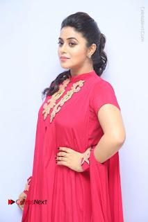 Actress Poorna Latest Stills in Red Dress at Rakshasi First Look Launch  0066.JPG