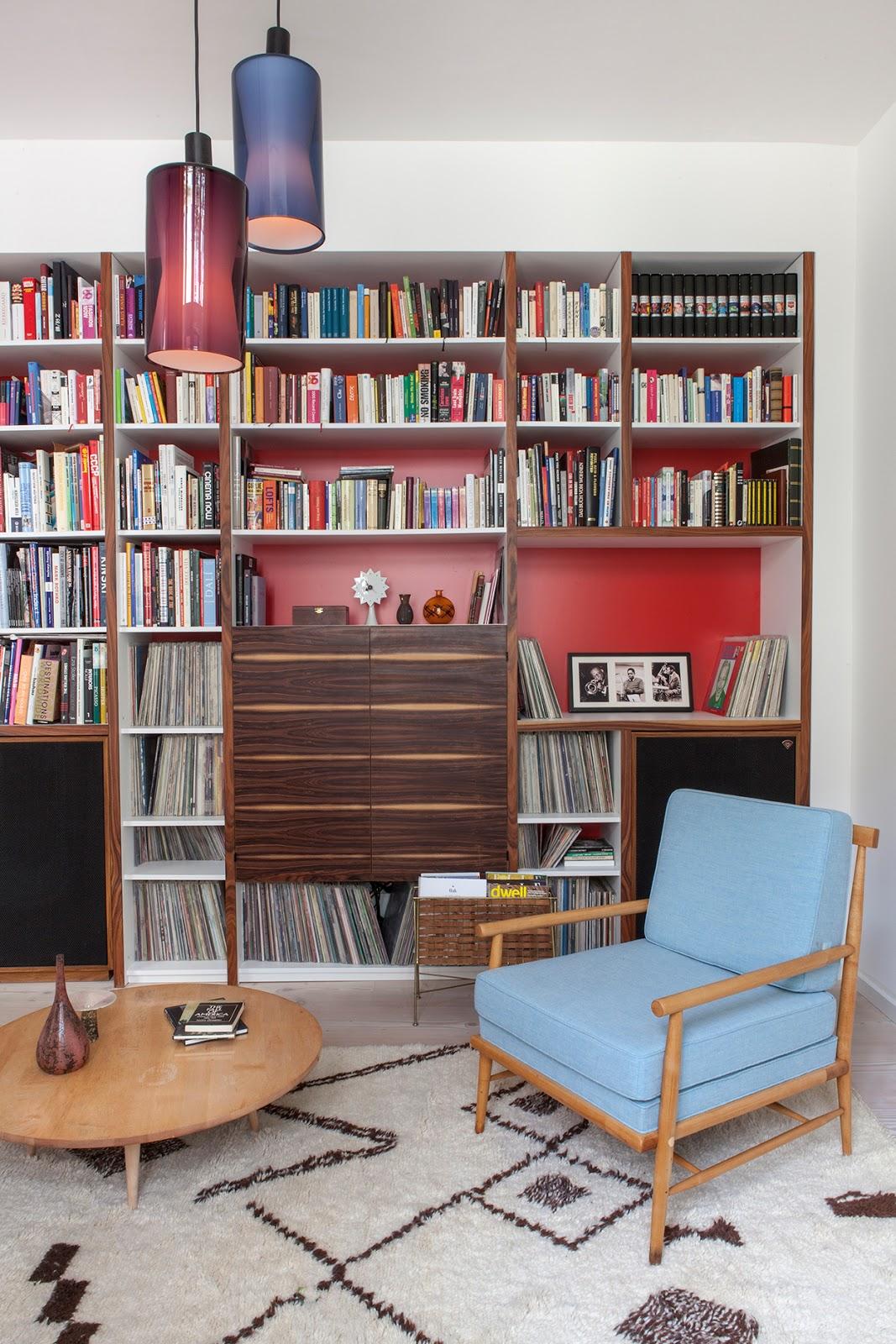 amazing designer loft in berlin with mdi century modern design, noguchi lamp, pattern carpet, pottery collection, light blue armchair