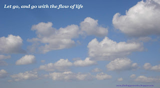 Image of fluffy white clouds in a blue sky with text: Let go, and go with the flow of life