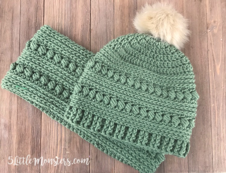It combines rounds of bead stitch with rounds of half double crochet and a  post stitch ribbing. A faux fur pom pom on the top finishes the hat. e8a9e37cebd