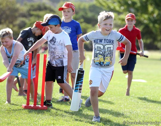 Front: Astin Jones, 8, taradale, playing non-stop cricket - Superstar Cricket, an after-school cricket programme run by Taradale Cricket Club, at Taradale Park, Taradale, Napier, in cloudy, sunny, warm late afternoon weather. photograph
