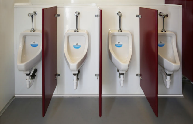 Four porcelain urinals