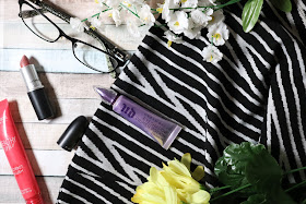 Makeup items, glasses and a black and white skirt