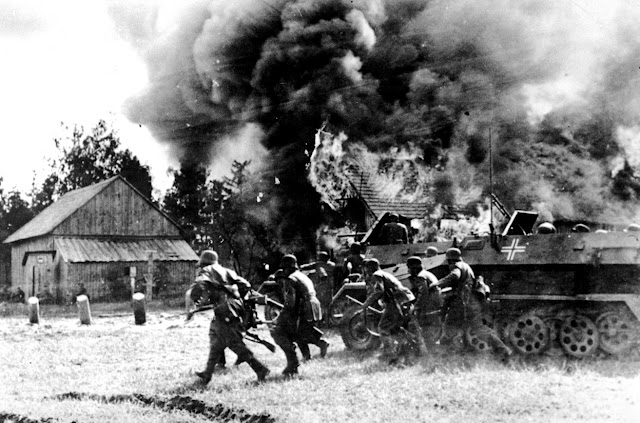 German troops assault a burning Soviet village 26 June 1941 worldwartwo.filminspector.com