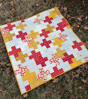 http://ablueskykindoflife.blogspot.com/2015/01/love-plus-baby-quilt-finish.html