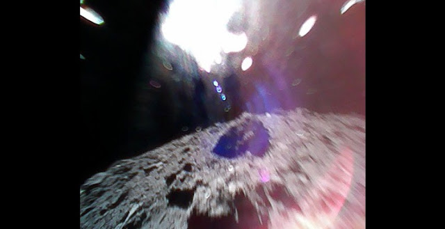 Color image captured by Rover-1A on September 22, 2018, while moving (during a hop) on the surface of asteroid Ryugu. Photo Credit: JAXA