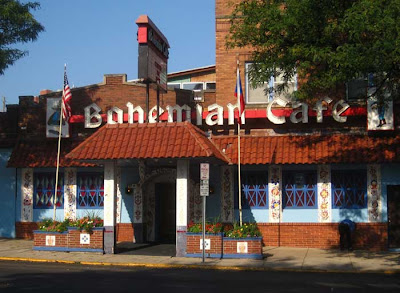 Bohemian Cafe sign in black letter, with hand-painted tiles around