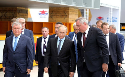 Vladimir Putin with Deputy Prime Minister Dmitry Rogozin and Rosneft CEO Igor Sechin, left, at Zvezda shipyard.