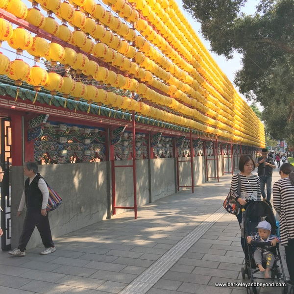yellow lanterns decorate exterior of Longshan Temple/Mengjia Longshan Temple in Tapei, Taiwan