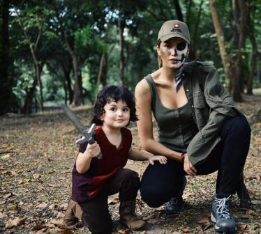 Sarah Lahbati as Skeleton Soldier and son Zion as Little Panday