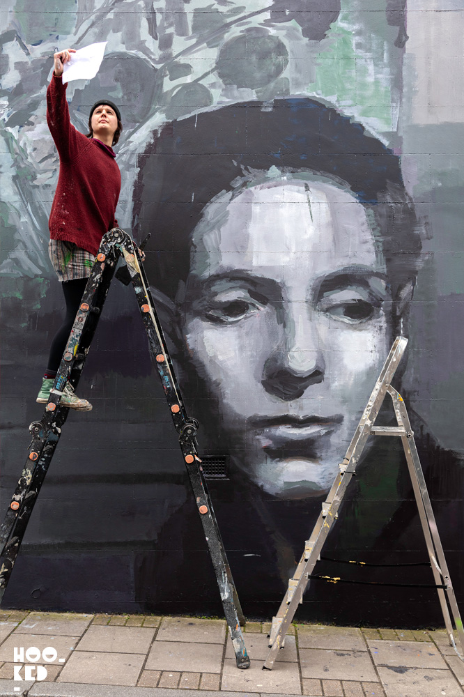 Artist Erin Holly at work on a mural of Gluck (Hannah Gluckstein) for LGBTQ+ History Month