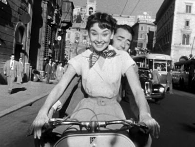 Roman Holiday actors on a Vespa