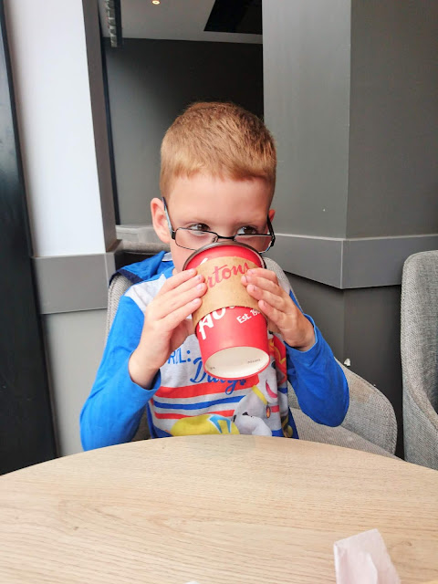 Dylan drinking hot chocolate in Tim Hortons. Project 365 Day 201 on the 20th July 2018 from Us Two Plus You