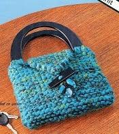 http://crochetenaccion.blogspot.com.es/2012/03/cartera-2-agujas.html