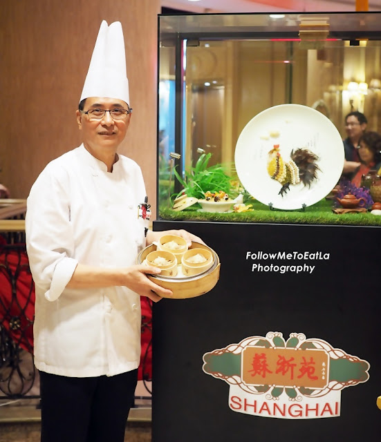Shanghainese Master Chef Wong Wing Yeuk Posing With His Famous Handmade Meat Dumplings