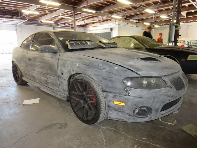 2005 Pontiac GTO in the bodyshop getting repairs and paint