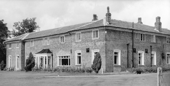 Photograph: After the fire which destroyed Brookmans House in 1891 the stables were remodelled as a dwelling house. The house is now the clubhouse for Brookmans Park Golf Club.