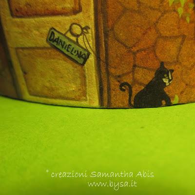 Case dipinte sui sassi gatto
