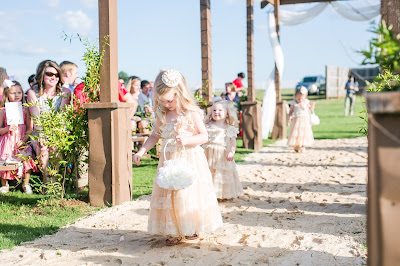 Rustic barn wedding meets vintage fairy tale. Meadow Creek Farm North Alabama Wedding Venue. Vintage Beauty and the Beast inspired wedding reception decoration ideas. Flower girl dress