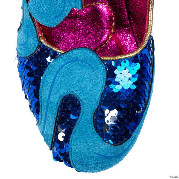 close up of blue sequins toe of shoe with blue suedette swirl