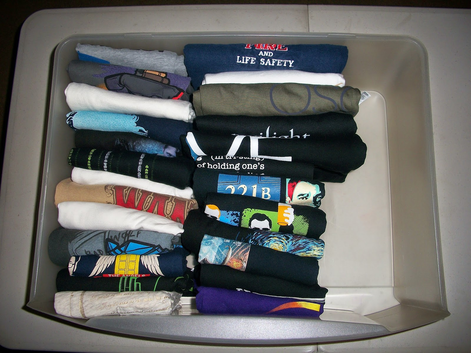 Shirts folded and stored in a drawer like a filing cabinet
