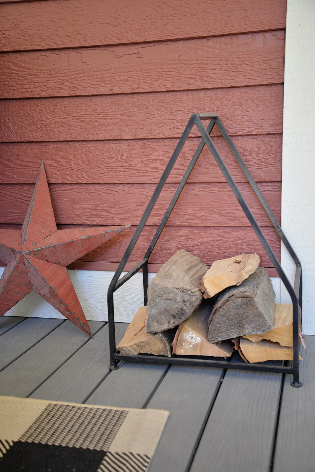 iron log holder, house log holder