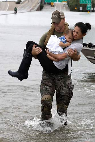 Photo-of-mother-and-baby-symbol-of-Hurricane-Harvey-2