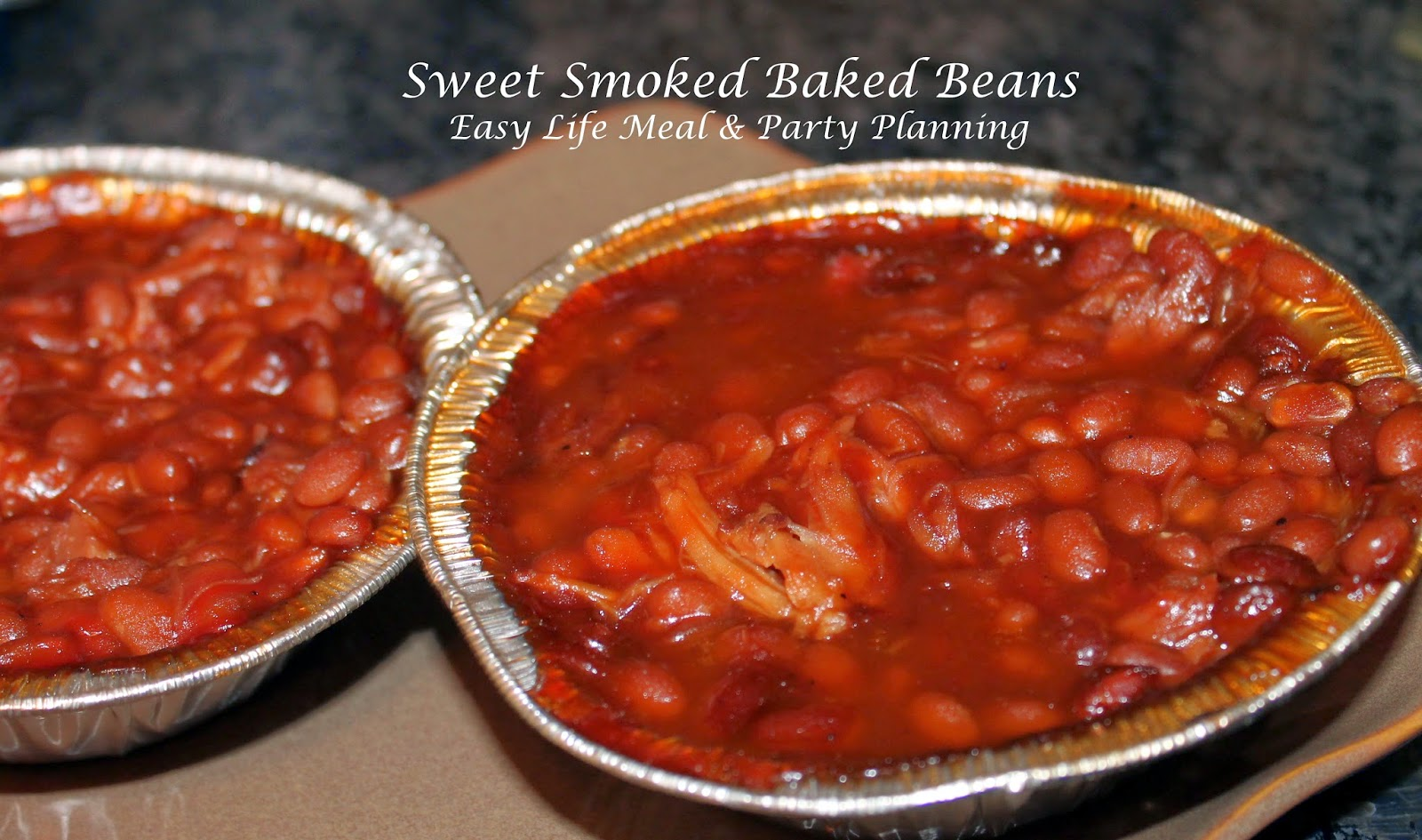 Smoked Sweet Baked Beans - Easy Life Meal & Party Planning - Brown sugar along with chunks of homemade smoked pork and the woody smoke flavor is a winning combination