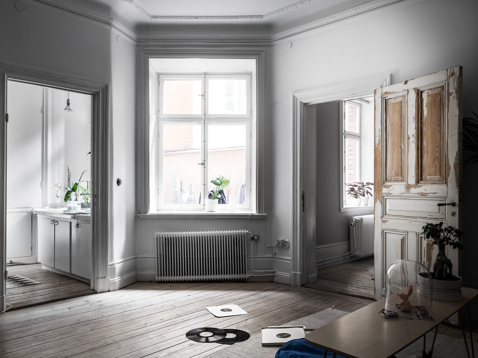 high ceilings apartment with wooden floors, white painted walls, danish design, scraped paint