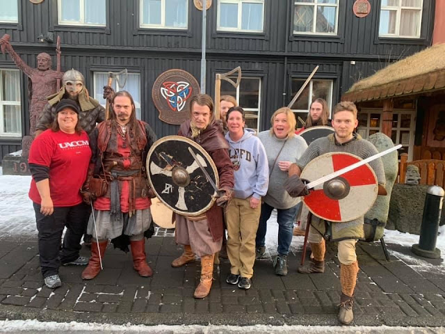 Group of people with costumed vikings