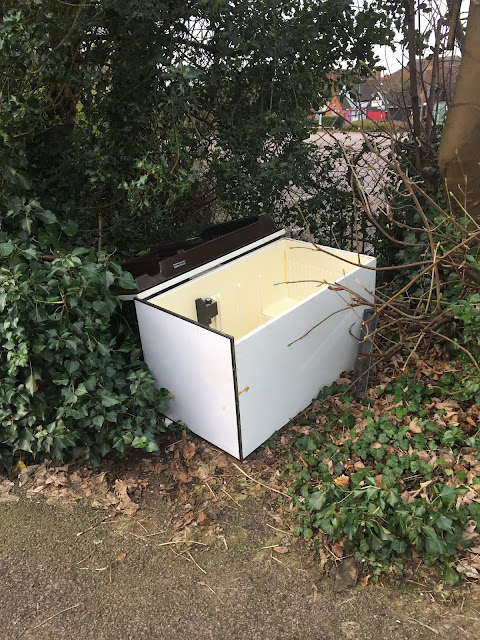 picture of a dumped fridge freezer