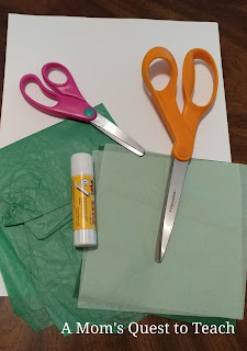 Supplies for craft - scissors, glue stick, paper