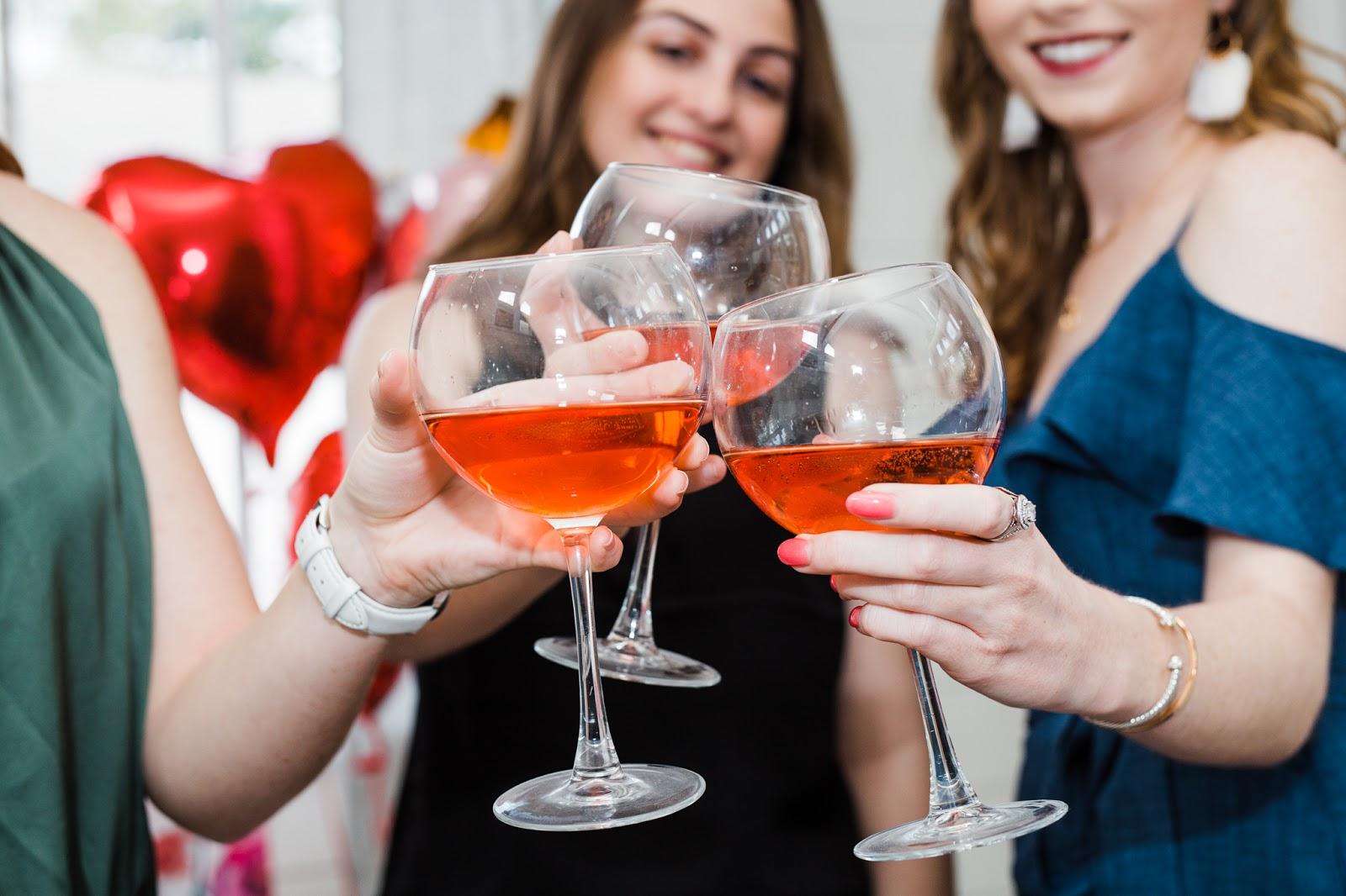 girls drinking wine on valentine's day