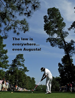 Photo of Bubba Watson reading The Law is Everywhere...even Augusta!