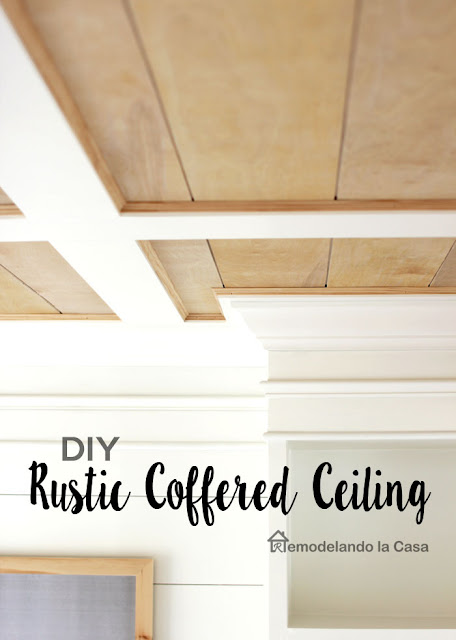 wood tone and white coffered ceiling in dining room