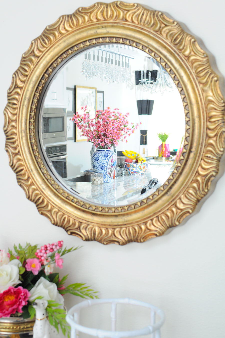 Gold mirror over a bar cart helps add light to a space.