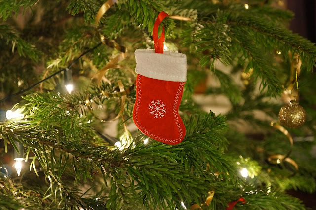 Christmas tree with stocking decoration on