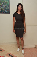 Priya Vadlamani super cute in tight brown dress at Stone Media Films production No 1 movie announcement 021.jpg