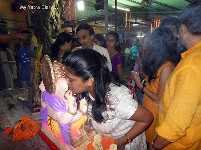 Devotees whispering their wish in the ear of Lord Ganesha ahead of Ganesh Visarjan - Mumbai
