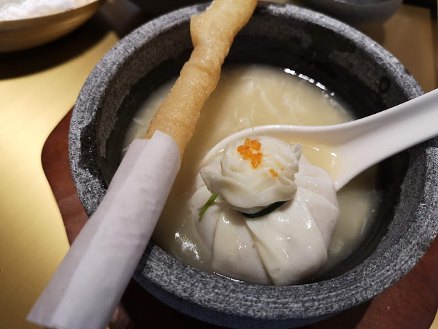 Braised Sea Treasure Soup in Pomegranate Egg White Parcel accompanied with Prawn Spring Roll