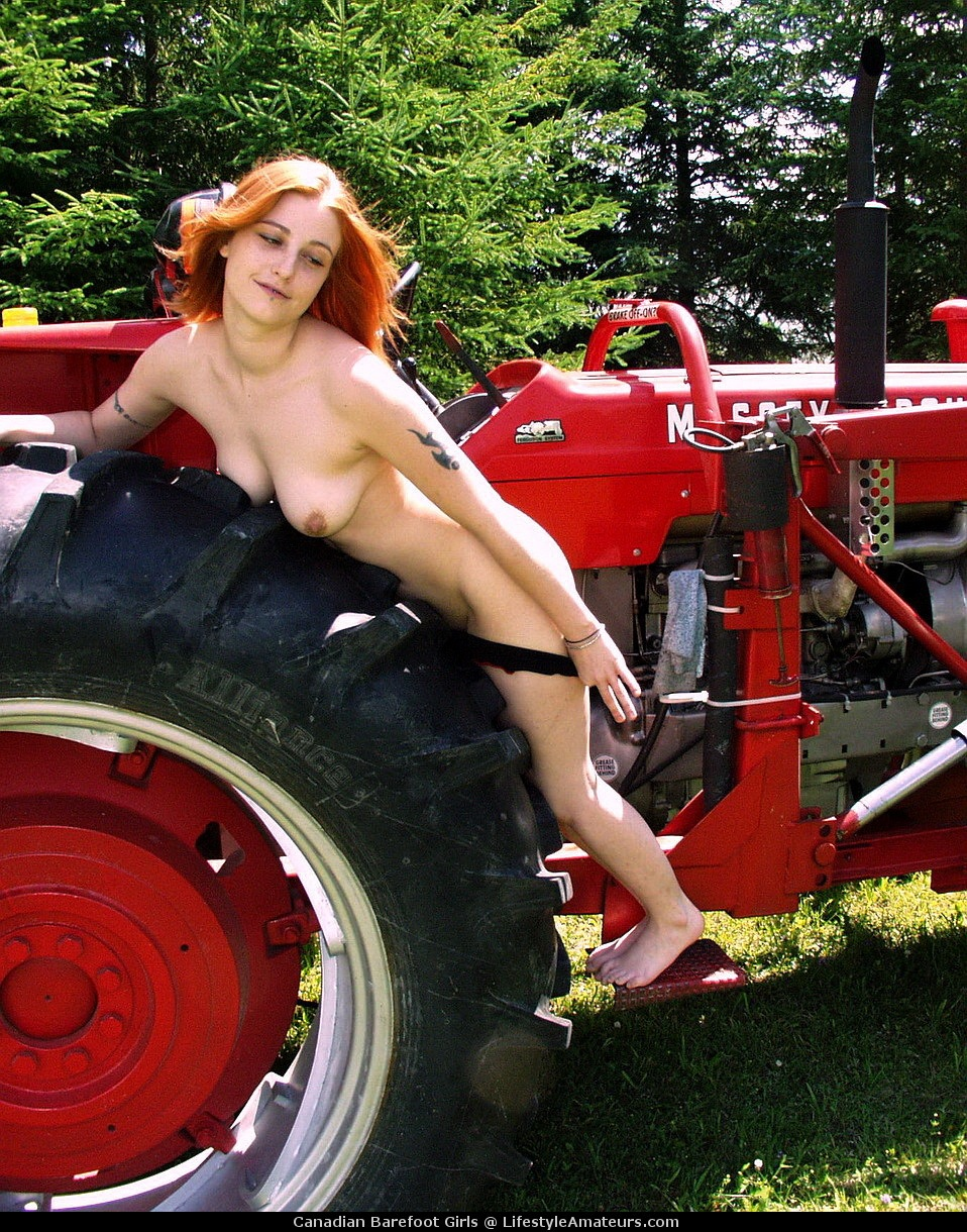 Woman posing nude with tractor — pic 15