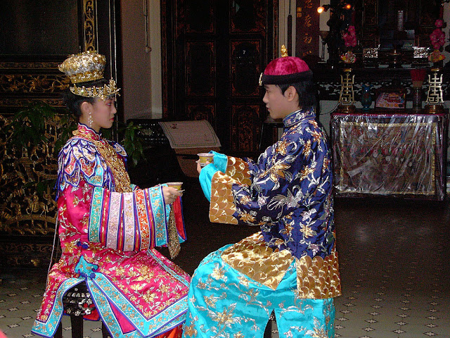 Peranakan bride and groom in traditional dress