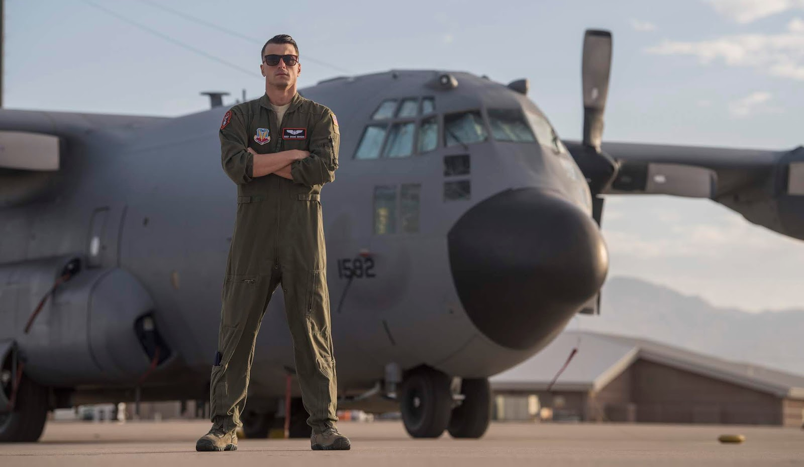 Air Force airman standing in front of a plane