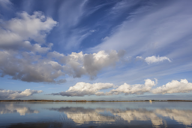 Clouds float over Grafham Water on a sunny afternoon in Cambridgeshire